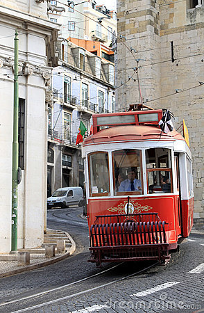 Riding tram in narrow, curvy street, Lisbon Editorial Stock Image