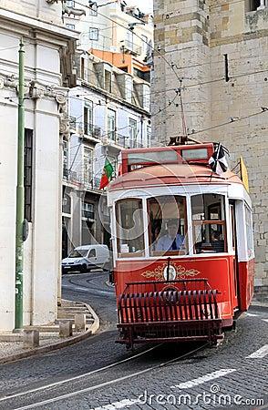 Riding tram in narrow, curvy street, Lisbon Editorial Stock Image