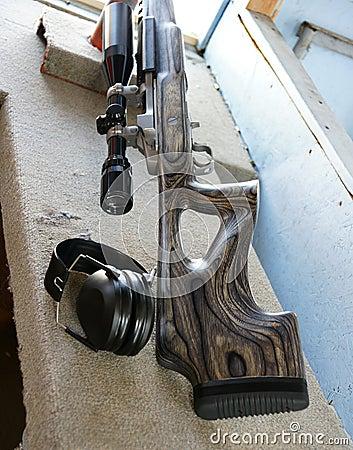 Rifle and earmuff