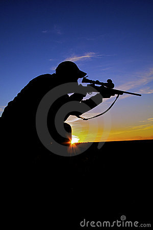 Rifle Hunter Shooting at Sunrise