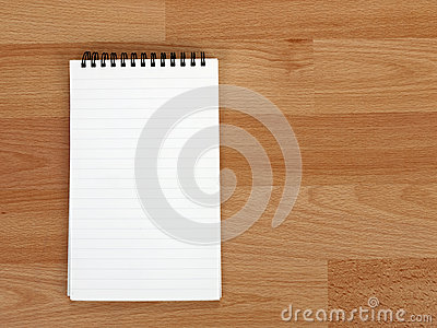 Ring aka spiral bound note pad on desk, blank
