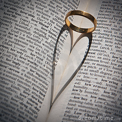 Ring casting a heart-shaped shadow in a book.