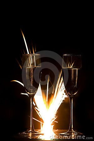 Rings in champagne glass and firework