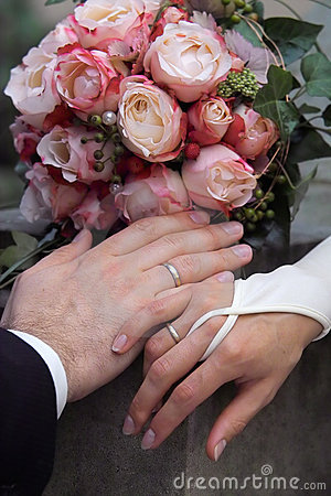 Rings, hands and bouquet