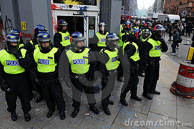 Riot Police Guard a Bank at Riot in London Editorial Stock Image