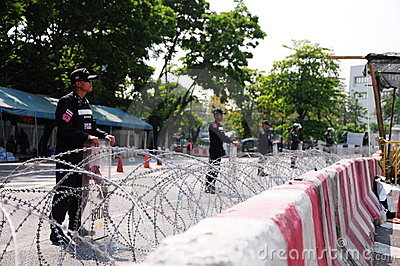 Riot-police guarding Government House in Bangkok Editorial Image