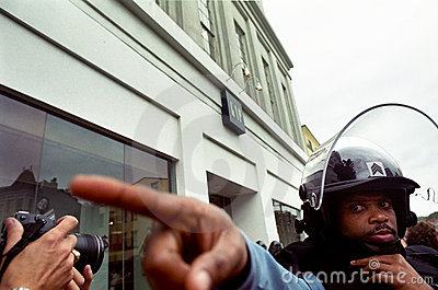 Riot Police and Photographer Editorial Stock Photo