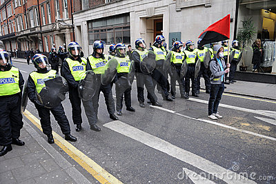 Riot Police and Protester in London Editorial Photography