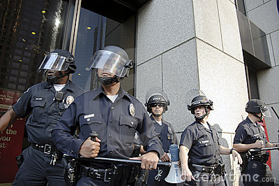 Riot police stand guard during Occupy LA march Editorial Stock Image
