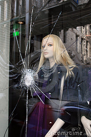 Riots aftermath, cracked glass, mannequin Editorial Image