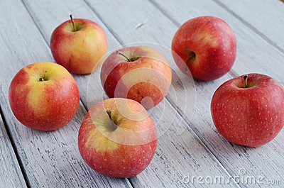 Ripe apples on shabby wooden table
