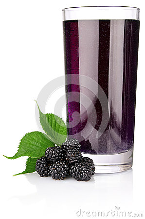 Ripe blackberry with green leaf and juice in glass