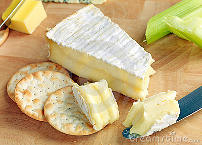 Ripe Brie on a cheeseboard