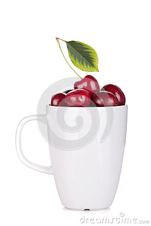 Ripe cherries in a cup