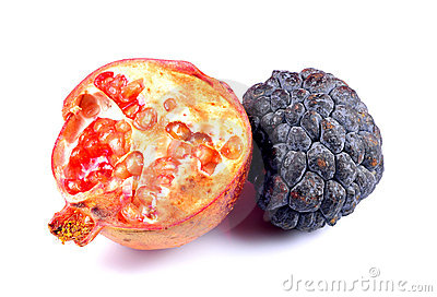 Ripe custard apple with half cut pomegranate