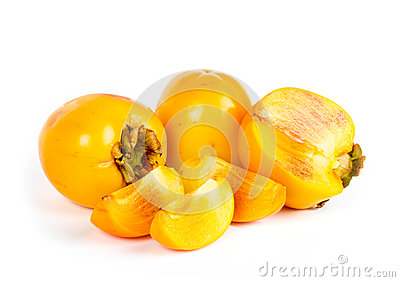 Ripe juicy persimmons with cuts on white