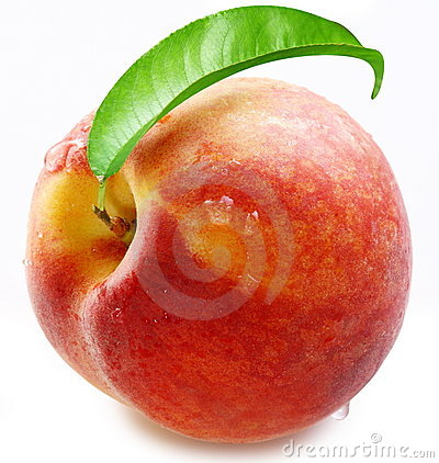 Ripe peach with a leaf.