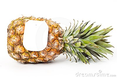 Ripe pineapple with a price tag