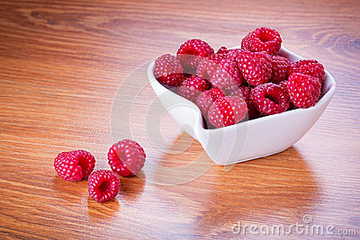 Ripe raspberries in the bowl