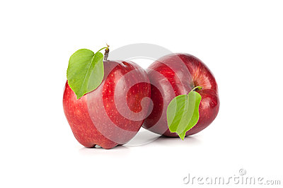 Ripe red apple with a leaf
