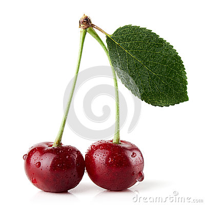 Ripe red cherries with leaf