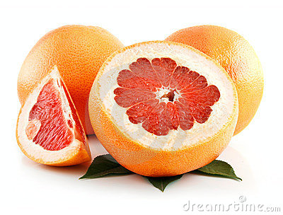 Ripe Sliced Grapefruit with Leaves Isolated