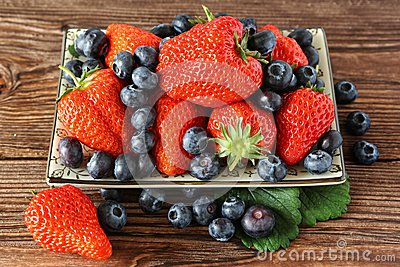 Ripe strawberries and blueberries