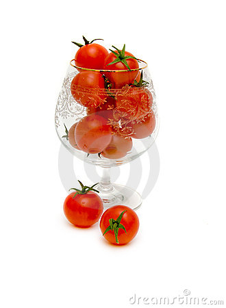 Ripe tomatoes in a glass.