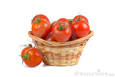 Ripe tomatoes in a wicker basket