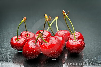 Ripen cherries against black background