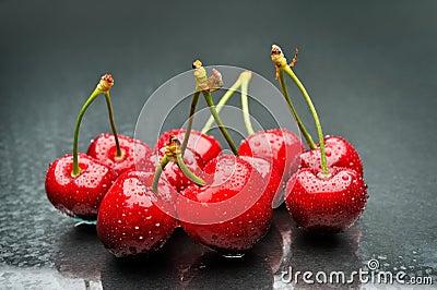 Ripen cherries against black background