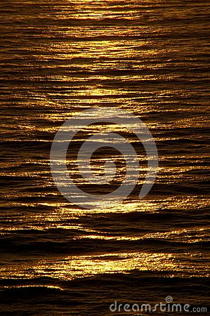 Free Rippled Ocean Surface Glows With Rich Copper Color At Sundown Stock Photography - 118901312