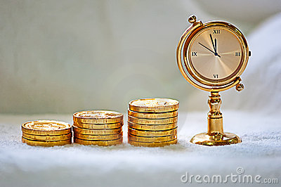 Rising pile of gold coins with a clock