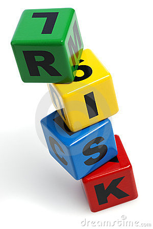 RISK spelled with stacked alphabet building blocks