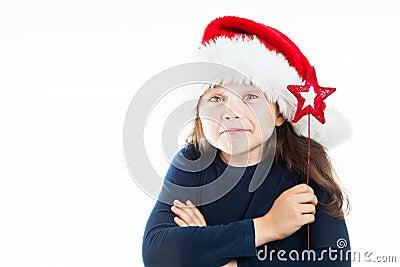 Ritratto di piccola ragazza sporgente le labbra di Natale