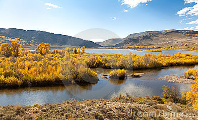 River, Aspen Trees and Mountains in Autumn