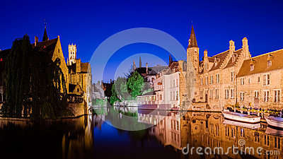 River canal and medieval houses at night, Bruges