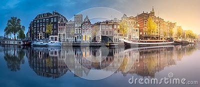 River, canals and traditional old houses Amsterdam Stock Photo