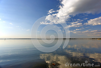 River and clouds with reflection in water
