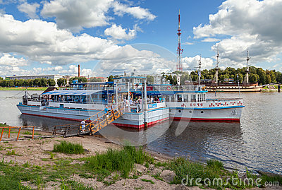 River cruise passenger catamaran at the moored on Volkhov river Editorial Stock Image