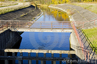 River dam and reflections on water background