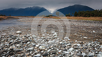 River from Fox glacier with rock foreground