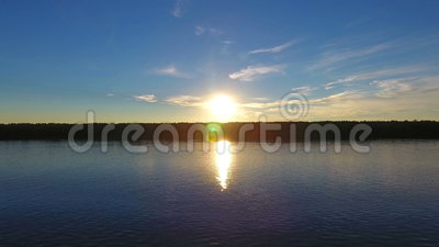 River in front of the sunset, aerial view stock video footage