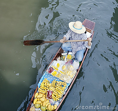 River fruit vendor, floating market, Bangkok, Thai