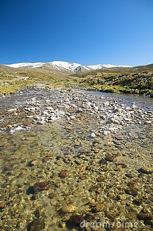 River at gredos snow mountains