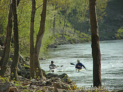River landscape and canoeing