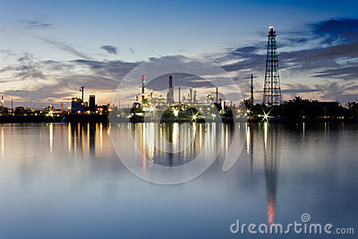 River and oil refinery factory with reflection