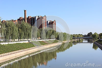 a river and storied building
