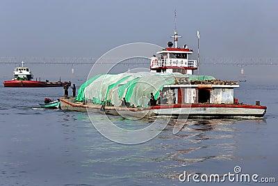 River Traffic - Irrawaddy River - Myanmar Editorial Stock Photo