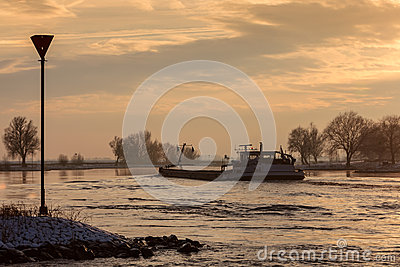 Riverboat during winter on the Dutch river IJssel